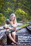 Cute little girl with bear on tracks Royalty Free Stock Photos