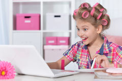Cute little girl beautifying herselves Stock Photography