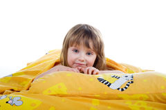 Cute little girl on the bed Royalty Free Stock Photos