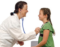 Cute Little Girl Being Examined By Lady Doctor Royalty Free Stock Photos