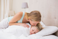Cute little girl being tucked in Stock Photos