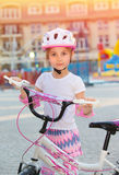 Cute little girl with bicycle. Having fun outdoors in summer day, training to cycling, happy childhood, enjoying active life Stock Photo