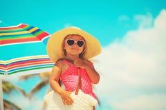 Cute little girl with big bag on beach. Cute little girl with big bag on tropical beach Stock Images