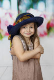 Cute little girl in big blue hat Stock Photos