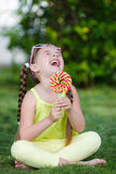 Cute little girl with big colorful lollipop. Royalty Free Stock Images