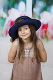 Cute little girl in big hat posing Stock Images