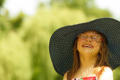 Cute little girl in big hat pretending to be lady Royalty Free Stock Photo