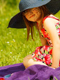 Cute little girl in big hat pretending to be lady Stock Photography