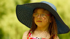 Cute little girl in big hat pretending to be lady Royalty Free Stock Image