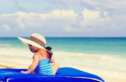 Cute little girl in big hat on summer beach Royalty Free Stock Photography