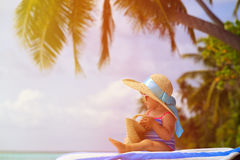Cute little girl in big hat on summer beach Royalty Free Stock Image