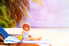 Cute little girl in big hat on summer tropical Stock Photo