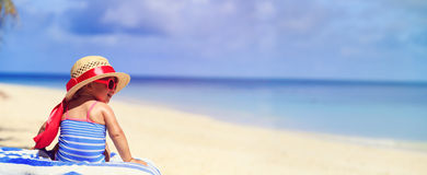 Cute little girl in big hat on tropical beach Stock Image