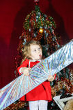 Cute little girl with big sweet christmas gift Royalty Free Stock Images