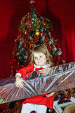 Cute little girl with big sweet christmas gift Royalty Free Stock Photo