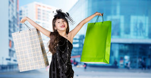 Cute little girl in big wear with packages Royalty Free Stock Photography