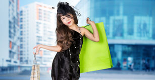Cute little girl in big wear with packages Stock Photography