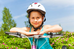 Cute little girl with a bike Royalty Free Stock Photography
