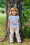Cute little girl on birch tree Royalty Free Stock Images