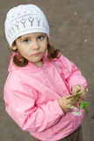 Cute little girl with blossoming cherry twig Stock Photography