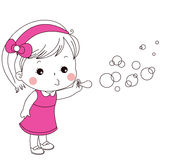 Cute little girl blowing bubbles Stock Images