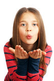 Cute little girl blowing on his hands. On a white background Royalty Free Stock Images