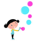 Cute little girl blowing Soap bubbles. Royalty Free Stock Images