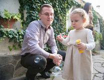 Cute little girl blowing soap bubbles Royalty Free Stock Photography