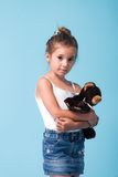 Cute little girl on blue background Royalty Free Stock Images