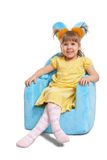 Cute little girl in blue chair Royalty Free Stock Photo