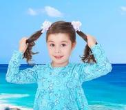 Cute little girl in a blue dress Stock Photo