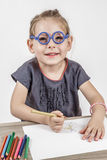 Cute Little Girl with Blue Glasses Stock Photos