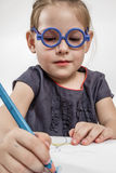 Cute Little Girl with Blue Glasses Royalty Free Stock Images