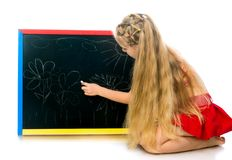 Cute little girl with a board Royalty Free Stock Photography