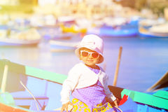 Cute little girl in boat of Marsaxlokk, Malta Royalty Free Stock Image
