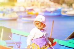 Cute little girl in boat of Marsaxlokk, Malta Royalty Free Stock Image