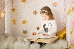Cute little girl with a book Royalty Free Stock Photo