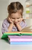 Cute little girl with a book Royalty Free Stock Photos