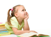 Cute little girl with books stock photo