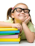 Cute little girl with books Royalty Free Stock Photos