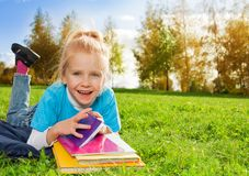 Cute little girl with books in park Royalty Free Stock Photos