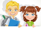 Cute little girl and boy with textbook hold white banner Stock Photo