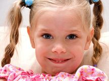 Cute Little Girl in Braided Pig Tails. This cute little 4 year old girl is wearing braided pig tails and smiling Royalty Free Stock Photography