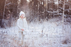 Cute little girl breathing on the walk in winter frozen forest Royalty Free Stock Photography