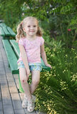 Cute little girl with broken knees Royalty Free Stock Photography