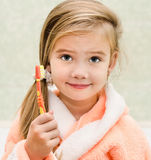 Cute little girl with brush Stock Images