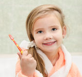 Cute little girl with brush in bath Stock Image