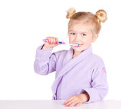 Cute little girl brushing teeth Royalty Free Stock Photography