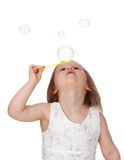 Cute little girl and bubbles Stock Images
