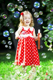 Cute little girl with bubbles Royalty Free Stock Photography